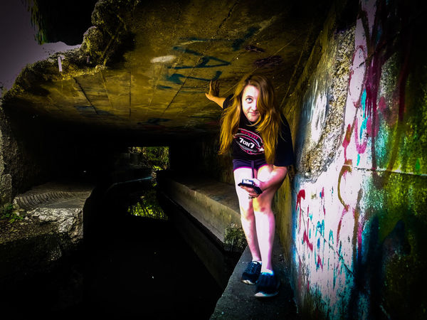 Girlfriend under tunnel One Person Young Adult Young Women People Special Day Special Moments Secretplace Special Moment Underneath Secret Architecture Leisure Activity Love Special Place Secret Places Graffiti