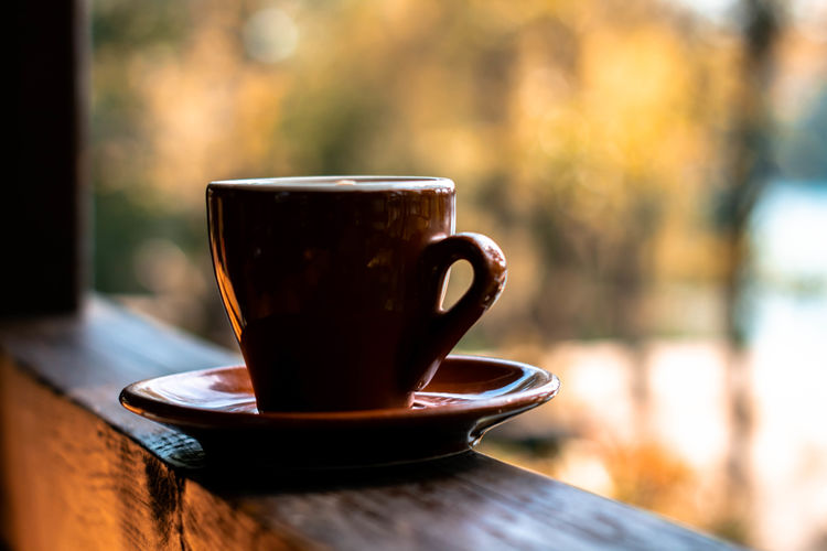 Close-up Coffee Coffee - Drink Coffee Cup Crockery Cup Day Drink Focus On Foreground Food And Drink Freshness Hot Drink Indoors  Latte Mug No People Non-alcoholic Beverage Refreshment Saucer Still Life Table Tea Cup Wood - Material