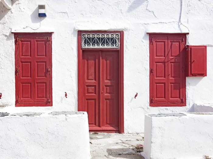 Door Red Entrance Architecture Built Structure Building Exterior Façade Outdoors No People Business Finance And Industry Day Whitewashed Travel Photography Travelling Photography Travelgram Photooftheday Travelphotography Mukonos Greece Greecestagram Greece Photos Greek Islands Greek_colours Travel Destinations Islandlife