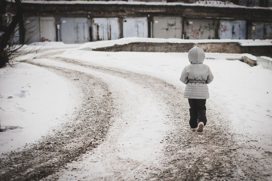 Alone Krasnoyarsk Lonely Russia Architecture Built Structure Childhood Cold Temperature Full Length Garage Girl Grey Jacket Little One Person Outdoors Real People Rear View Siberia Snow Walking Warm Clothing Winter