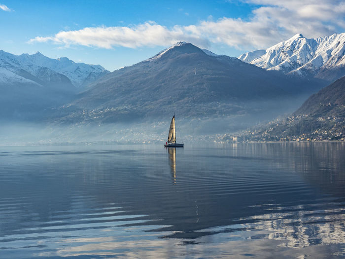 Sailboat on lake como at morning hours