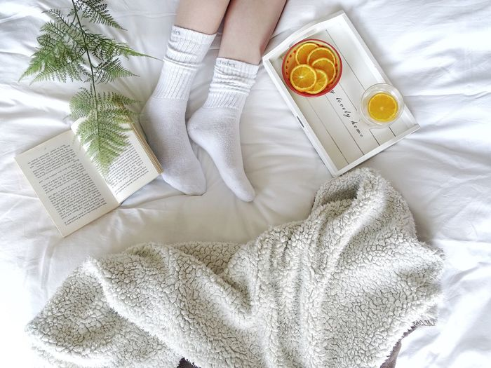 Relaxing moments Orange Fruit EyeEm Selects Lifestyle Sheet Blanket Book Drink Feet Frond High Angle View Indoors  Textile Bed White Color No People Still Life Close-up Directly Above Sheet Crumpled Lifestyles Celebration Clothing Linen Food And Drink Food Clean
