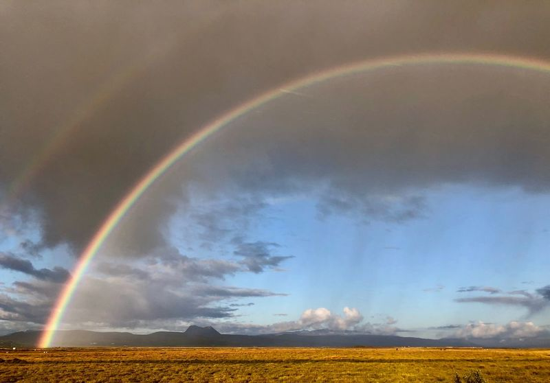 Double Rainbow Rainbow Beauty In Nature Landscape Environment Scenics - Nature Cloud - Sky Tranquility Sky Land Multi Colored Double Rainbow
