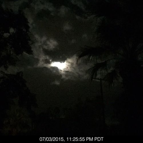 Moon peeking through the clouds tonight from home taken on iPhone 6