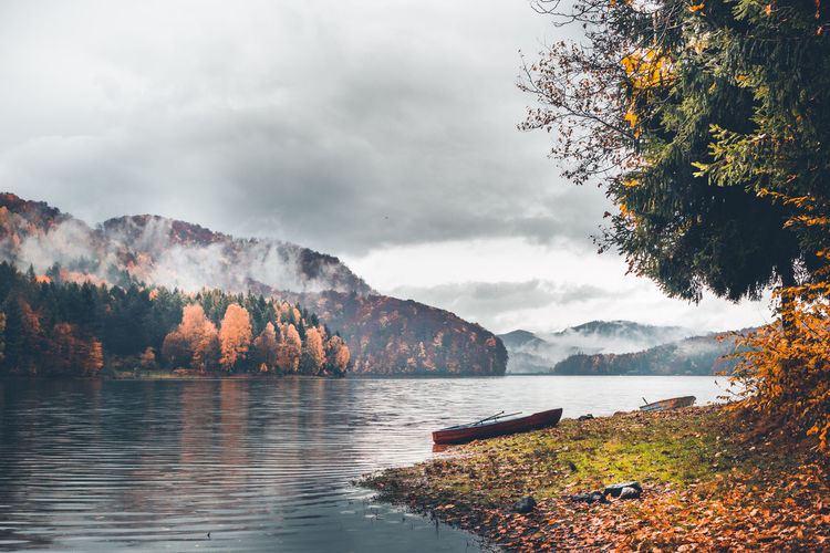 Water Tree Sky Beauty In Nature Plant Scenics - Nature Nature Tranquility Tranquil Scene Autumn Mountain Non-urban Scene Cloud - Sky Lake No People Nautical Vessel Day Change Outdoors Boat Fog Fall Beauty Fall Colors Autumn colors Nautical Equipment