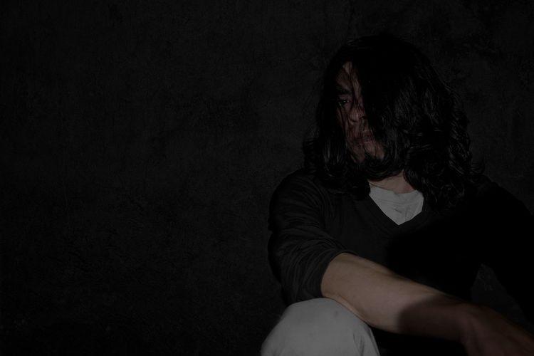 Woman in darkroom