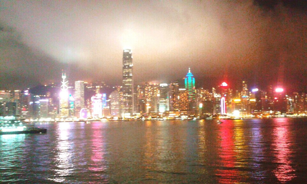 illuminated, building exterior, architecture, built structure, night, city, cityscape, skyscraper, waterfront, travel destinations, urban skyline, river, water, city life, downtown district, outdoors, sky, no people, multi colored