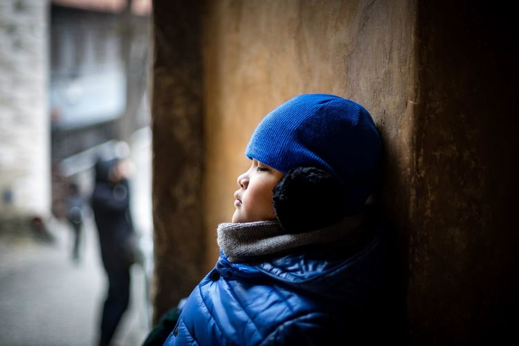 Asain Boy inside Cesky Krumlov castle Czech Republic Blue Casual Clothing Close-up Day Focus On Foreground Headshot Jacket Leisure Activity Lifestyles Outdoors Warm Clothing