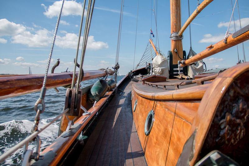 Sailing Boat On Sea Against Blue Sky