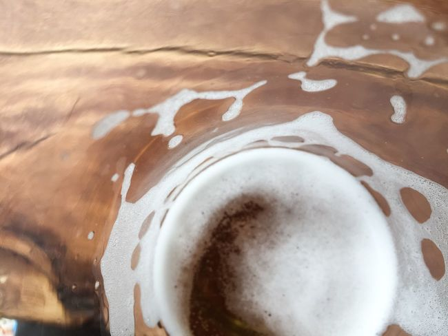 Telling Stories Differently Happiness At The Bottom Of A Glass Beer Swirl Foam Glass Wooden Table Glass Half Full