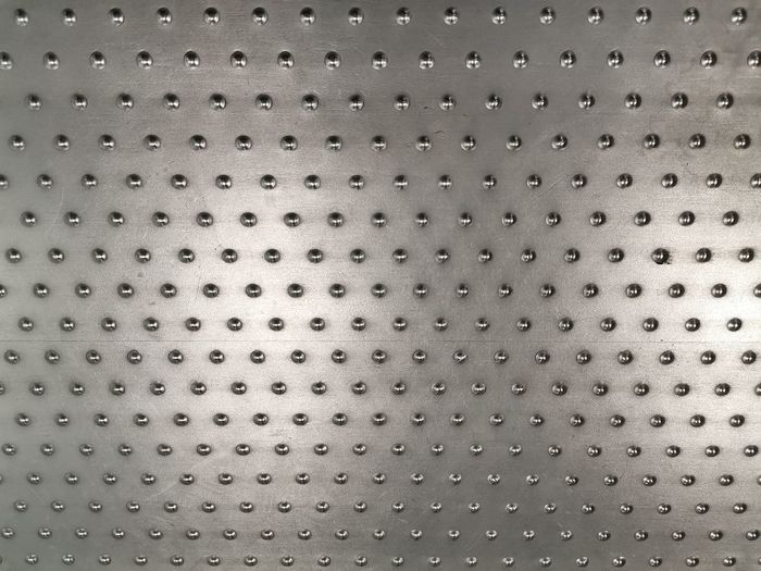 Full frame shot of raindrops on metal