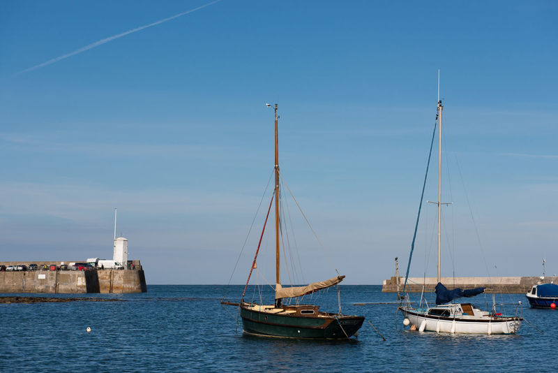Beauty In Nature Blue Boat Day Fishing Fishing Boat Mast Mode Of Transport Nature Nautical Vessel No People Northumberland Outdoors Rippled Sailboat Sailing Scenics Sea Seahouses Sky Tranquil Scene Tranquility Transportation Water Waterfront