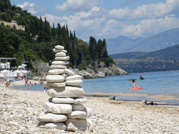Stone Beach Stone Castle Isand Water Seaside Mountain Rocks Beach Beauty In Nature Day Pile Of Stones Woods Trees And Sky Clouds