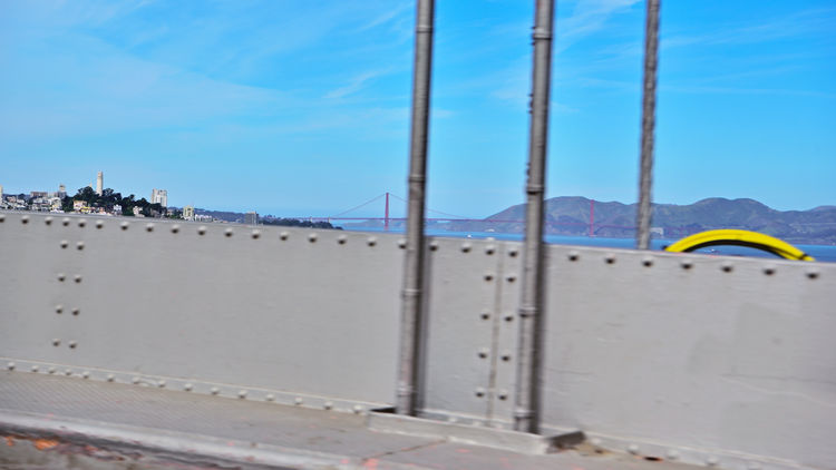 Crossing The Bay Bridge 1 The Bay Bridge Oakland To San Francisco, Ca. Westbound The Upper Span San Francisco Bay Vista Views Golden Gate Bridge Marin Headlands Telegraph Hill Coit Tower Urban Photography Cityscape View From The Bridge Blue Skys Driving Across Bridge Bridge Deck Bridge Cables