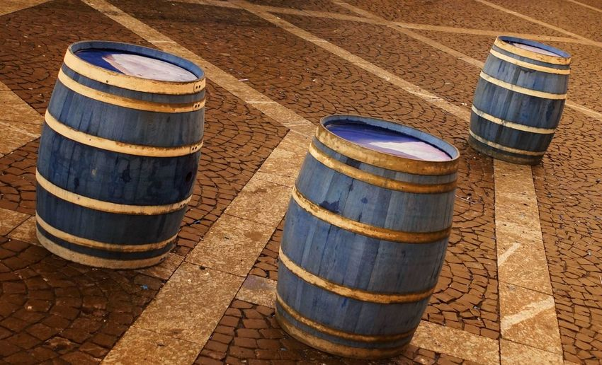 High angle view of barrels on footpath