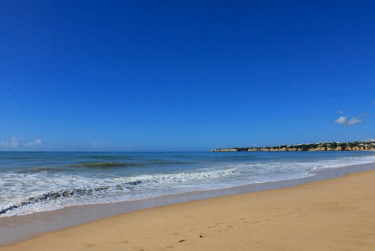Blue sky, beachy days Algarve Algarve Beach Armação De Pêra Beach Beauty In Nature Blue Blue Skies Blue Sky Calm Clear Sky Coastline Horizon Over Water Nature Portugal Portugal Beach Sand Scenics Sea Seascape Shore Summer Tranquil Scene Tranquility Vacations Water