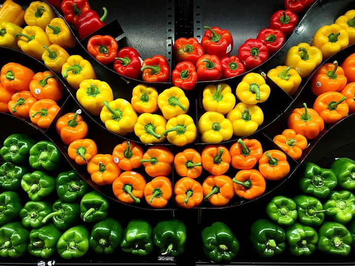 Full frame shot of various bell peppers arranged in shelf