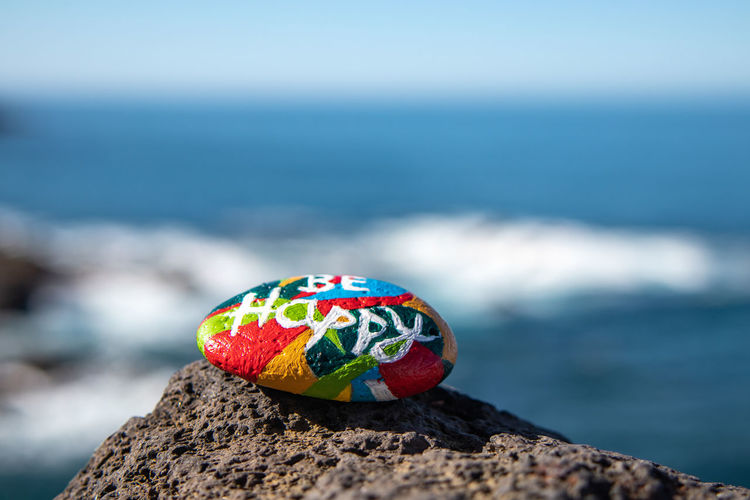 Close-up of multi colored rock on shore