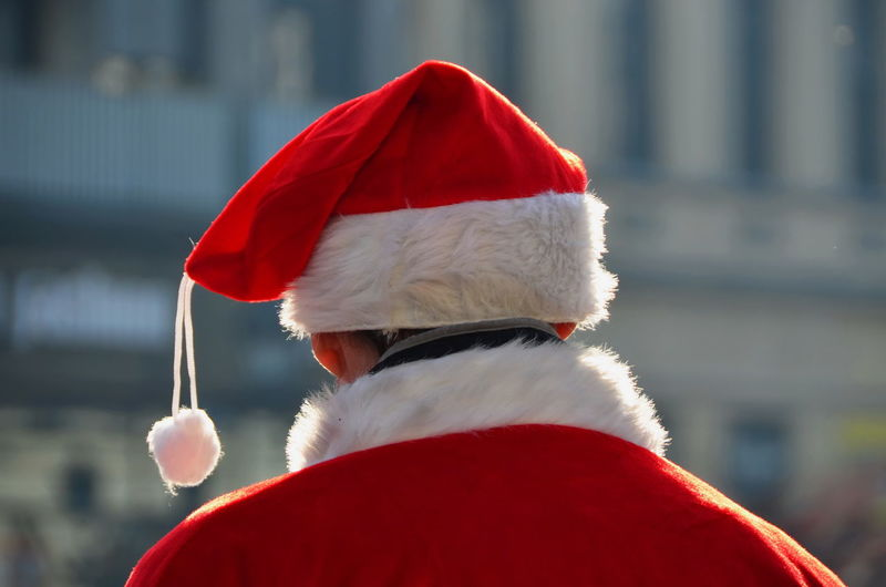 Rear view of man in santa claus costume