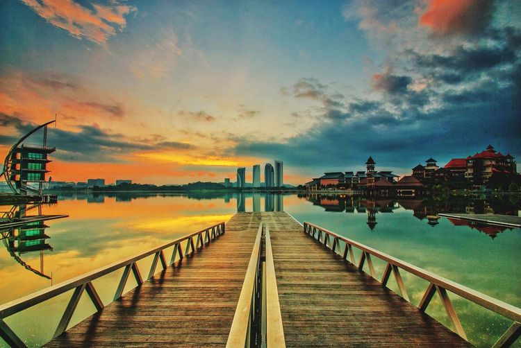 Tranquility of sunrise at Putrajaya Lake Water Cloud - Sky Outdoors No People Travel Destinations Beach Jetty View Wooden Jetty Putrajaya, Malaysia Tower Hotel Resorts Pullman Skating Surfing Landscape Waterscape Sunrise Reflection Sunset Multi Colored Horizon Over Water Beauty In Nature Scenics