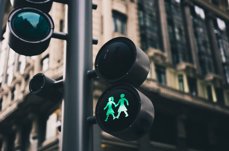Stoplight Sign Guidance Road Signal Road Sign Light City Focus On Foreground Green Light Close-up Road Illuminated Safety Building Exterior Architecture Built Structure Human Representation Day No People Representation Outdoors Crossing Sign