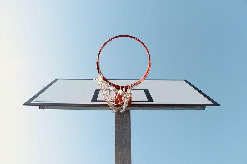 Directly below shot of basketball hoop against clear sky