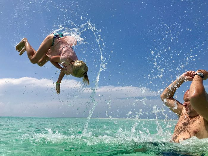 Playful flying over the Tanzanian sea. Upside Down Power Bright Trust Happiness Flying Joy Water Sea Motion One Person Real People Go Higher Leisure Activity Nature Sunlight Enjoyment Outdoors Splashing Blue This Is Family Visual Creativity Summer Exploratorium #FREIHEITBERLIN The Great Outdoors - 2018 EyeEm Awards The Traveler - 2018 EyeEm Awards Summer Sports Be Brave 50 Ways Of Seeing: Gratitude Moments Of Happiness #NotYourCliche Love Letter