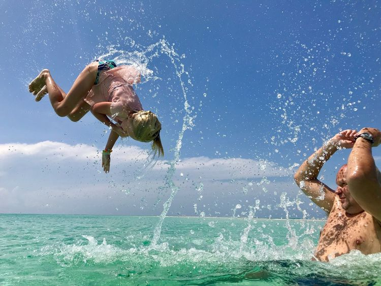Playful flying over the Tanzanian sea. Upside Down Power Bright Trust Happiness Flying Joy Water Sea Motion One Person Real People Go Higher Leisure Activity Nature Sunlight Enjoyment Outdoors Splashing Blue This Is Family Visual Creativity Summer Exploratorium #FREIHEITBERLIN The Great Outdoors - 2018 EyeEm Awards The Traveler - 2018 EyeEm Awards Summer Sports Be Brave 50 Ways Of Seeing: Gratitude Moments Of Happiness