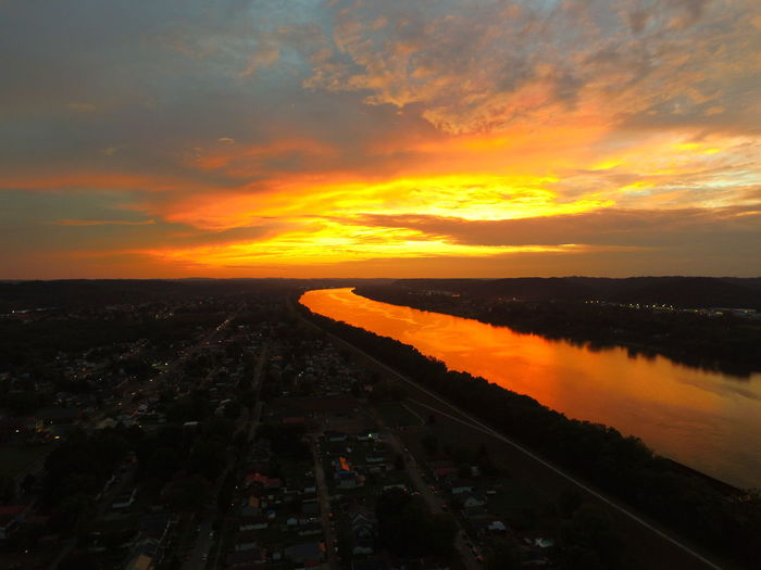 High Angle View Of Cityscape By Ohio River Against Orange Sky