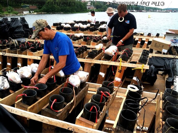 Garden State Fireworks techs load shells for big show. DaySailfest