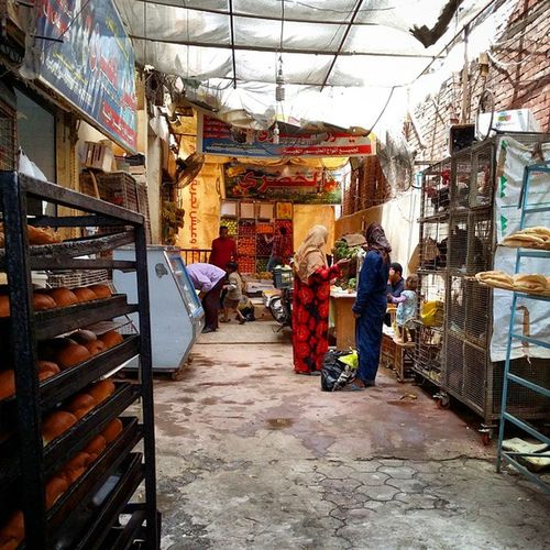 I love these little back street Shops in Egypt . Met some wonderful people today especially in the Bakery . Happyholidays holidays holiday vacation deankennedyphotography 2015 happyholidays2015bread fun happy masr