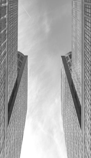 Black And White Modern Futuristic Copy Space Business Finance And Industry Building Exterior Architecture Built Structure Low Angle View Building Sky Cloud - Sky City Office Building Exterior Office Nature No People Tall - High Day Outdoors Skyscraper Business Glass - Material Wall - Building Feature Financial District  Directly Below