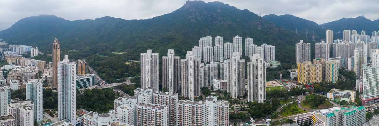 Panoramic shot of modern buildings in city against sky