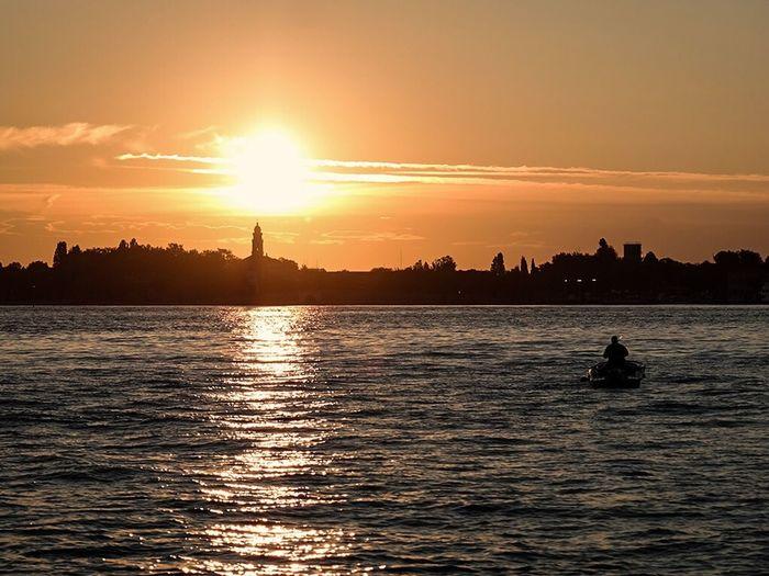 Boat at sunrise near Venice