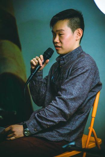Poet Men Portrait Man Asianboy Color Portrait Green Orange Atmospheric Scene Resident Of Yakutia Yakutianboy Speaker Open Microphone EyeEm Selects Musician Sitting Men Music Electric Guitar Musical Instrument Arts Culture And Entertainment Guitar Fretboard