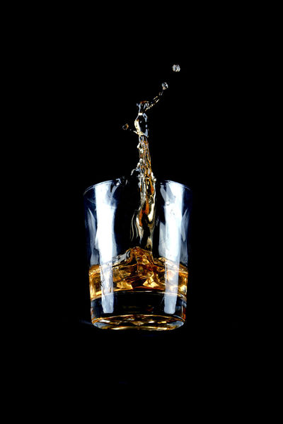 Falling Whiskey Glass DrinkStagram Whisky Alcohol Bar Black Background Close-up Drink Drinking Glass Dropes Foodphotography Frenchphotographer Freshness Glass High-speed Photography Highspeed Icecubes No People Studio Shot Waves Whiskey