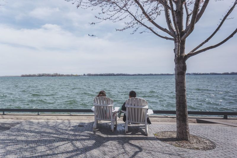 'Room for two' Rear View Water Sitting Outdoors Sky Tree Relaxation Two People Horizon Over Water Travel Destinations Photo Of The Day EyeEm Photography Editorial  Toronto Canada EyeEm Gallery Eyeemphotography EyeEm Masterclass Eye4photography  Photooftheday Eyeem Market Magazine Lake Lake View