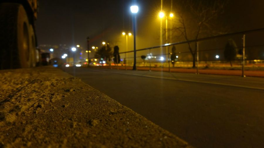 Surface level of illuminated street lights at night
