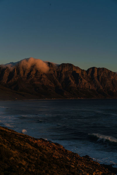 False Bay Mountain Views South Africa Beach Beauty In Nature Clear Sky Copy Space Day False Bay Hermanus Land Mountain Mountain Range Nature No People Non-urban Scene Outdoors Rock Rock - Object Scenics - Nature Sea Sky Solid Tranquil Scene Tranquility Water