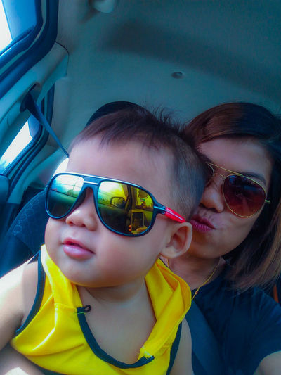 handsome Portrait Headshot Sunglasses Females Women Childhood Real People Glasses Front View Lifestyles Two People Child Leisure Activity Bonding Mode Of Transportation Vehicle Interior Mid Adult Togetherness Fashion Innocence Family Moments Of Happiness