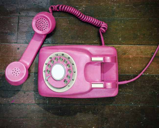 old pink phone Old-fashioned On The Phone... Close-up Communication Connection Directly Above Flooring High Angle View Indoors  Landline Phone No People Nostalgia Nostalgic  Of The Hook Old Phone Cord Pink Color Pink Phone Retro Styled Rotary Phone Still Life Technology Telephone Telephone Receiver