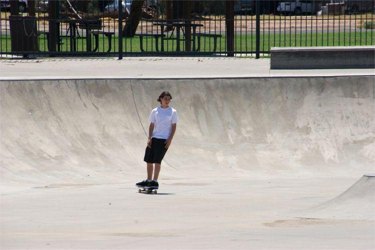 Young man skateboarding at park