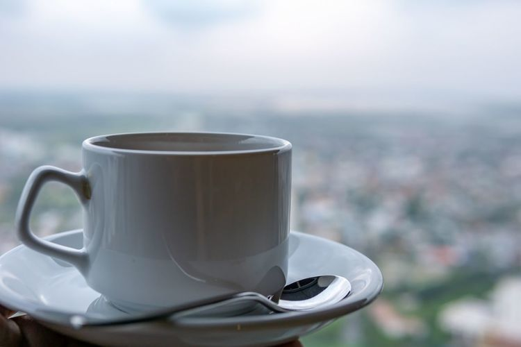 Coffee time with high view of the city. City Morning Close-up Coffee Coffee - Drink Coffee Cup Crockery Cup Day Drink Focus On Foreground Food And Drink Hot Drink Mug No People Non-alcoholic Beverage Refreshment Saucer Spoon Tea Tea Cup