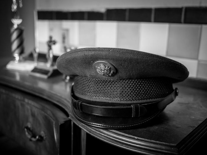 Close-up of uniform cap on table