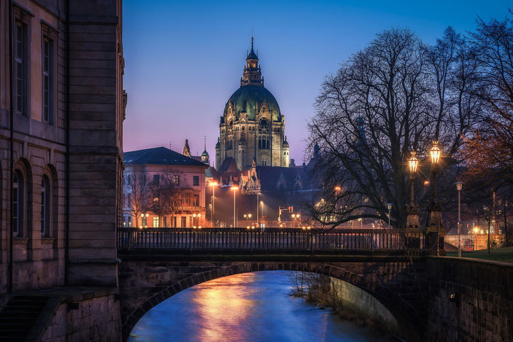 New town hall and leine castle during early morning Built Structure Architecture Building Exterior Water Bridge Building Illuminated Sky Travel Destinations Tree Tourism River Dusk Travel City No People Government Hannover Town Hall City Historical Building Historical Center Blue Hour Architecture EyeEm Best Shots
