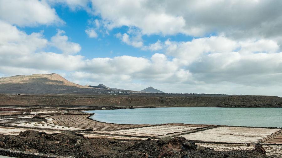 Scenic view of lanzarote salt basins against sky