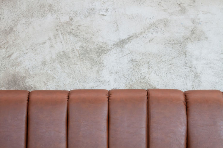 Close-up of sofa against white wall