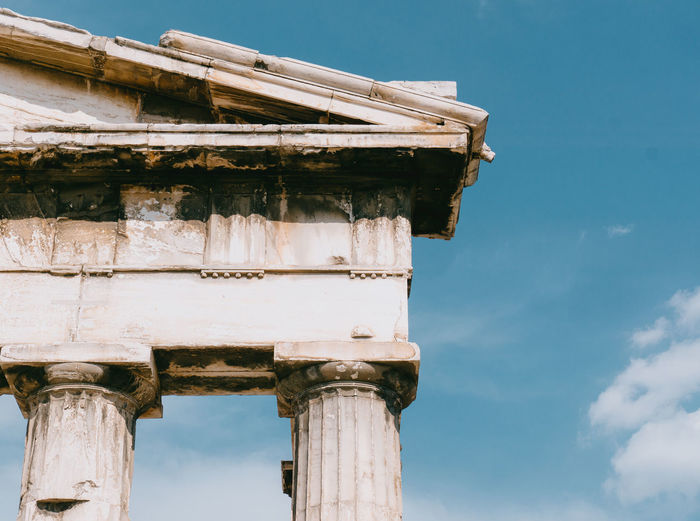 Low angle view of an ancient greek temple against sky