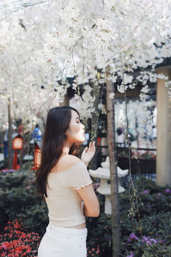 My Best Photo International Women's Day 2019 Streetwise Photography One Person Plant Real People Leisure Activity Hairstyle Lifestyles Standing Women Young Women Tree Young Adult Flowering Plant Long Hair Casual Clothing Flower Three Quarter Length Focus On Foreground Nature Growth Hair Beautiful Woman Outdoors Springtime