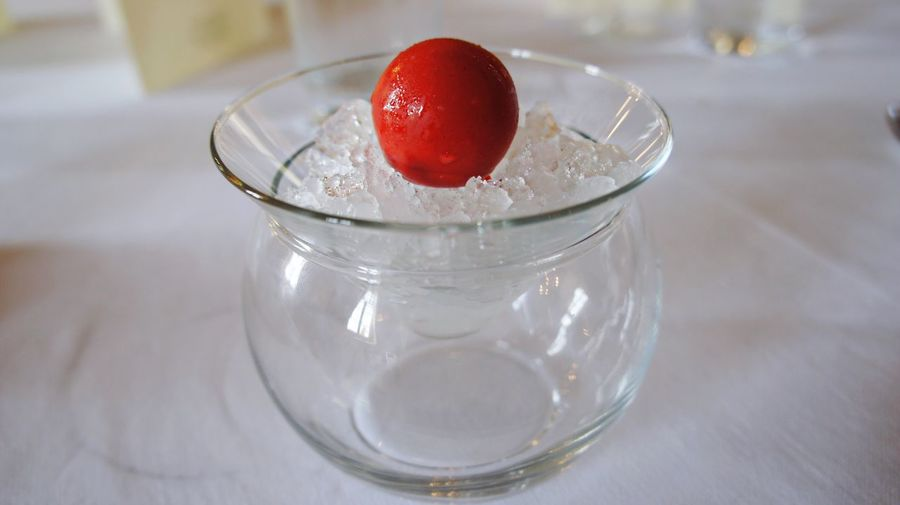 Close-up of fresh red chocolate on ice with vodka served on table